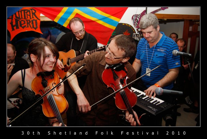 Ewen, playing one of his instruments, in the band Fullsciellidh Spelemannslag at Shetland's Folk Festival